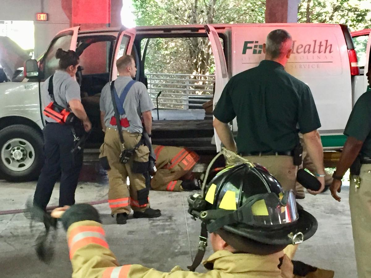 Firefighters respond to a vehicle fire on July 18, 2019, at FirstHealth Moore Regional Hospital in Pinehurst