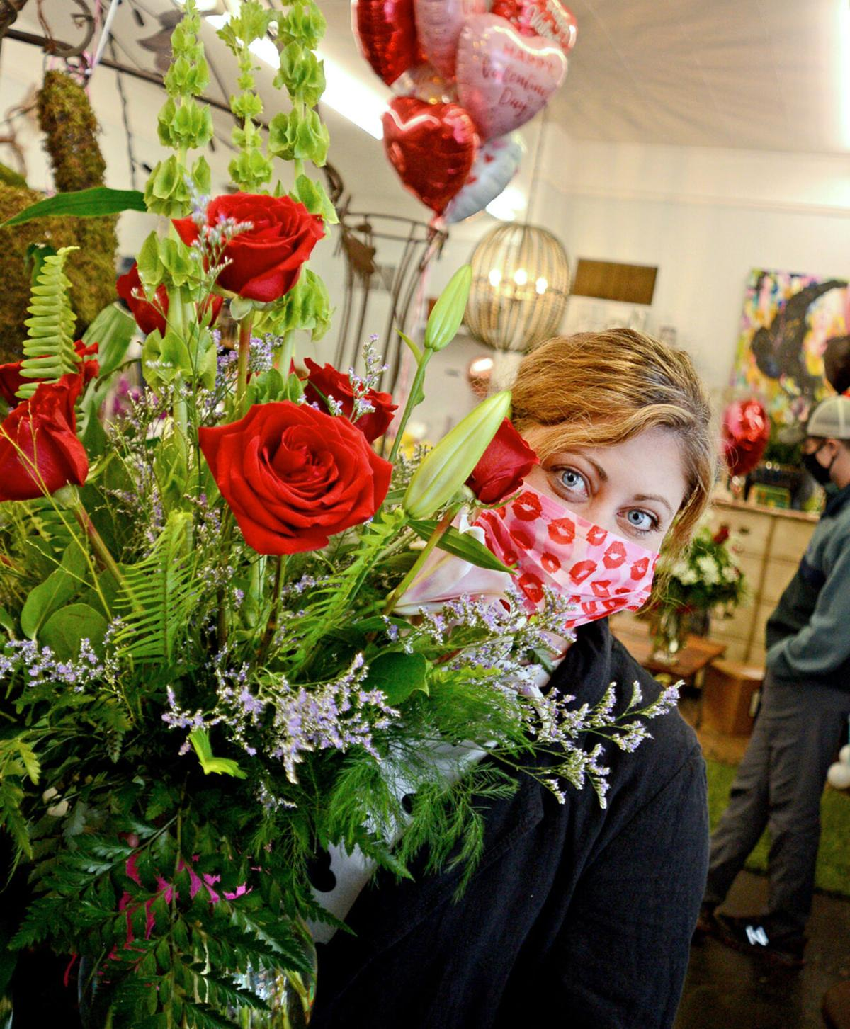 Leslie Habets, owner of Jack Hadden Floral and Event Design in Aberdeen, with a Valentine's Day bouquet