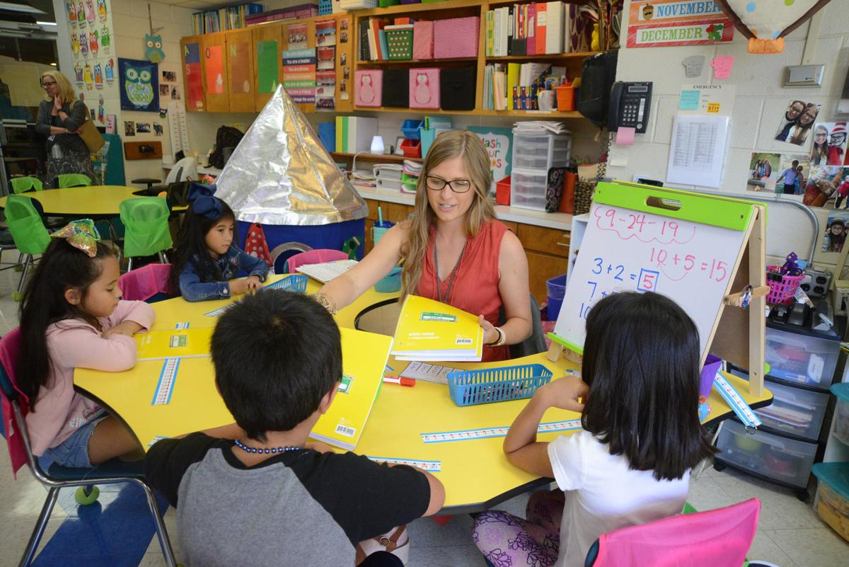 Lauren Thompson works with first grade students at Robbins Elementary School.