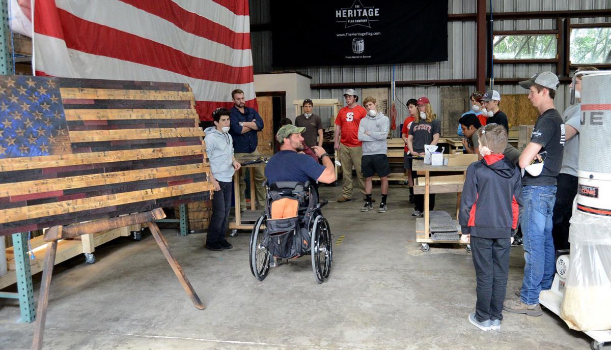 Pinecrest Students Pitch In At Heritage Flag Company