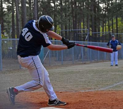 Junior Jacob Bates at bat.jpeg
