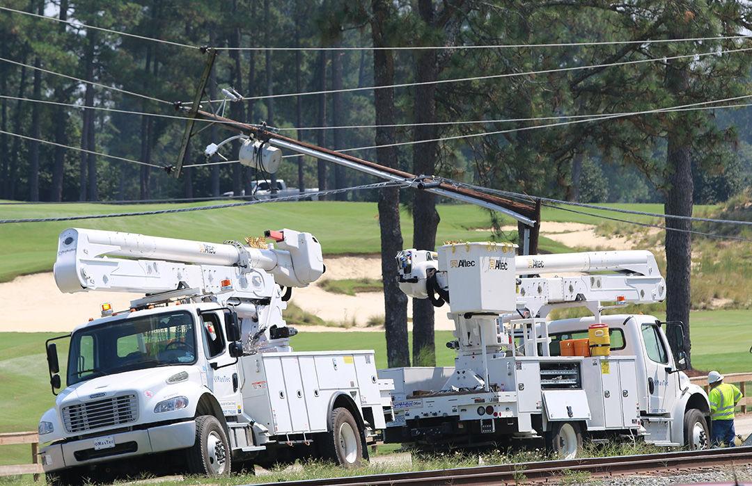 Linemen at the scene of a broken utility pole in Pinehurst on Sept. 9, 2019.