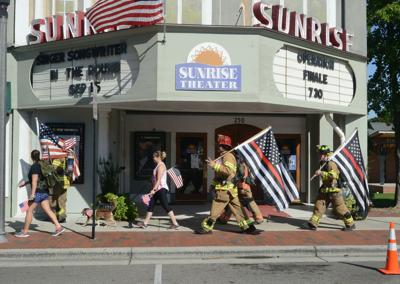 Firefighters march through downtown Southern Pines as part of a 9/11 memorial in 2018.