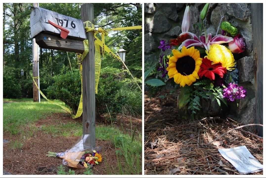 Flowers left by mourners in front of the Blacks' home.