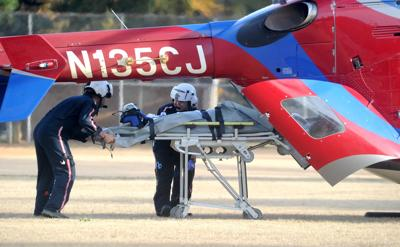 A young girl is placed on a helicopter at Memorial Park following a vehicle accident on Nov. 26, 2019.