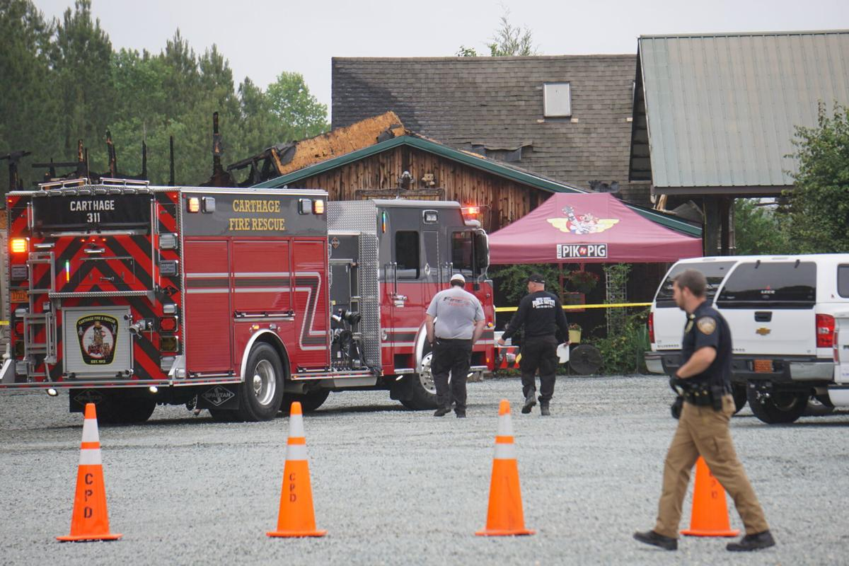 Firefighters at Pik 'N Pig in Carthage on May 30, 2021.