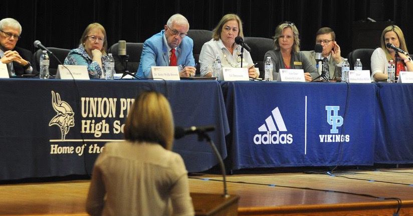 A speaker addresses the Moore County Board of Education during a redistricting hearing on Sept. 12, 2019