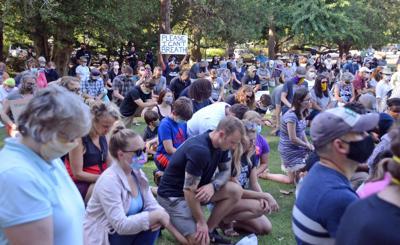 People kneel during a peace vigil in honor of George Floyd in Southern Pines on June 3, 2020.