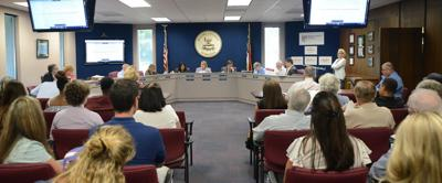 The Moore County Board of Education during a June meeting in which student surveys were discussed.
