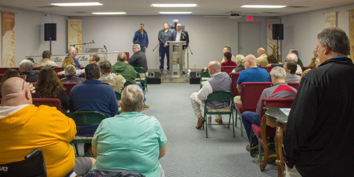 Cliff Brown, Jon Rachels and Sheriff Ronnie Fields address an audience of more than 50 people Tuesday at Crossway Church of Worship in Aberdeen.