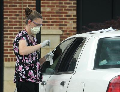 A nurse administers a COVID-19 test at FirstHealth Convenient Care in Taylortown.