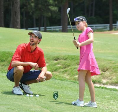 ohn Wainwright,  a coach at U.S. Kids Golf Academy at Longleaf,