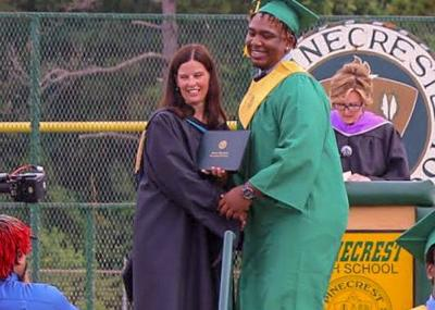 Elijah McCormick accepts his diploma