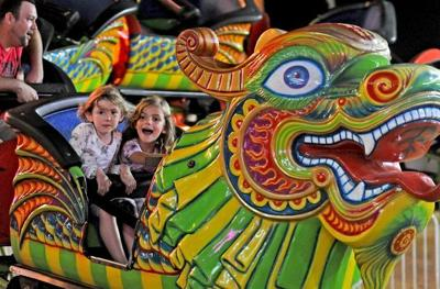 Children on an amusement ride at the 2019 Moore County Agricultural Fair.