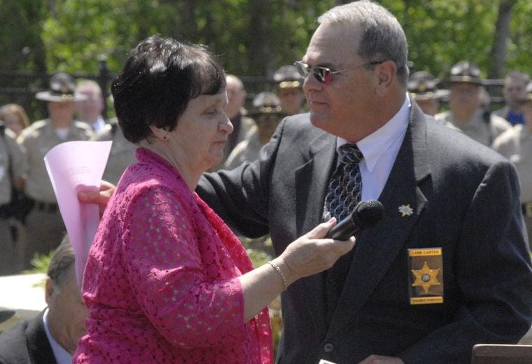 Sheriff Lane Carter hugs Wanda Rhyne