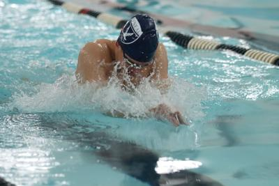 Tim Richardson breaks 24 year old record in his 100 yard breaststroke at state meet.JPG