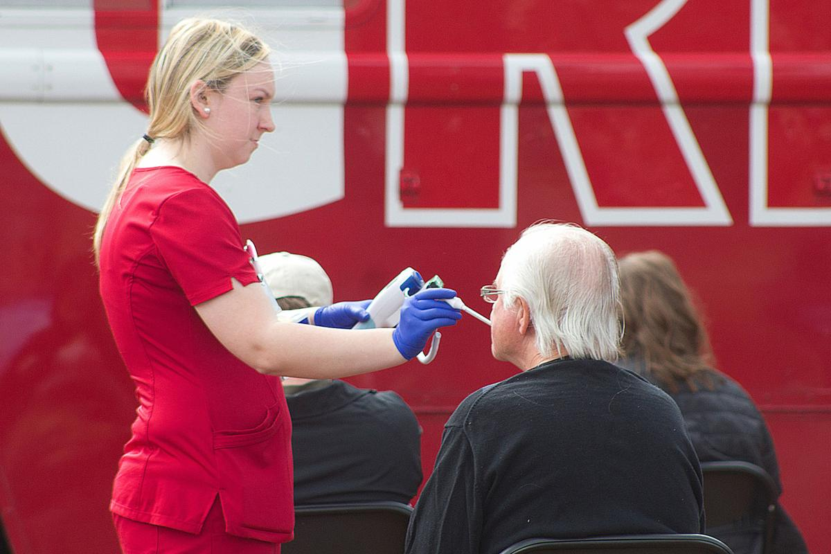 A nurse checks the temperature of a donor waiting to give blood at FirstHealth Moore Regional Hospital