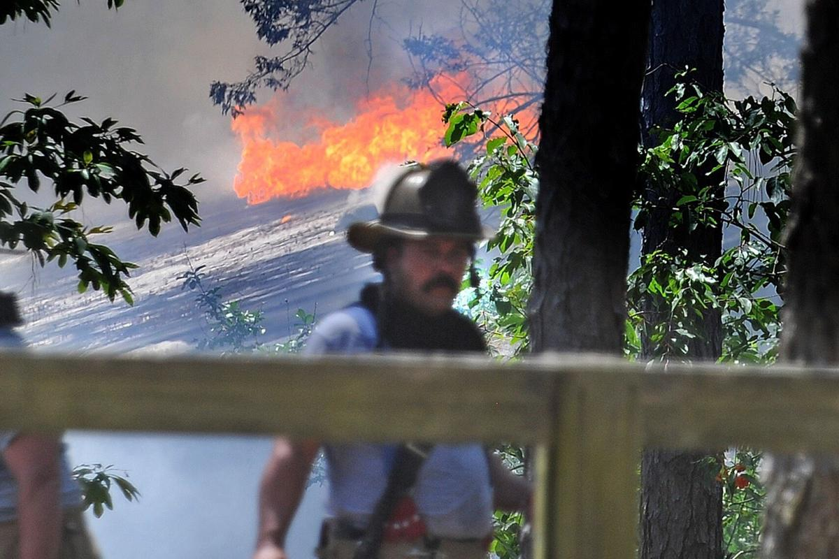 Firefighters respond to a blaze on Lakebay Road in Vass.