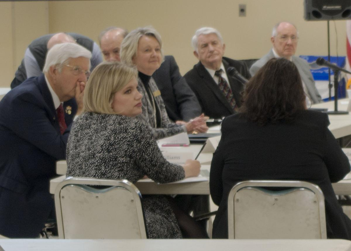 County commissioners listen to comments from a resident