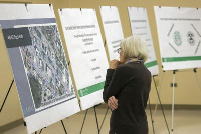 A woman views plans for a proposed expansion of the county courthouse