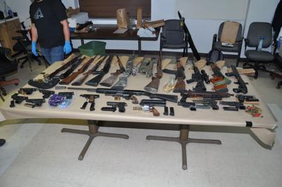 South Bend man charged after 2 kilos of meth, dozens of guns and cash seized in St. Joseph County search