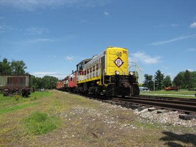 EL 310 leads a passenger train over the former C&O mainline of Indiana