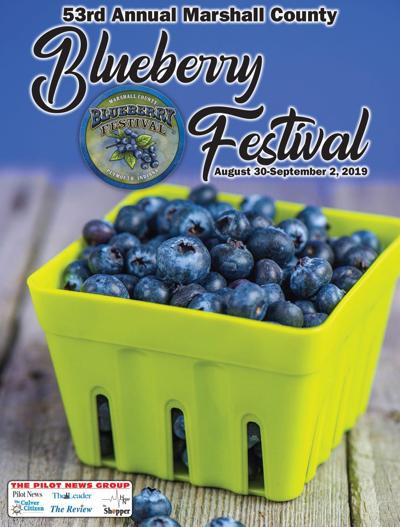 A staple of Blueberry Festival, demand high for blueberry donuts on opening day