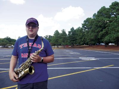 Proving passion: Visually impaired student marches in LMB