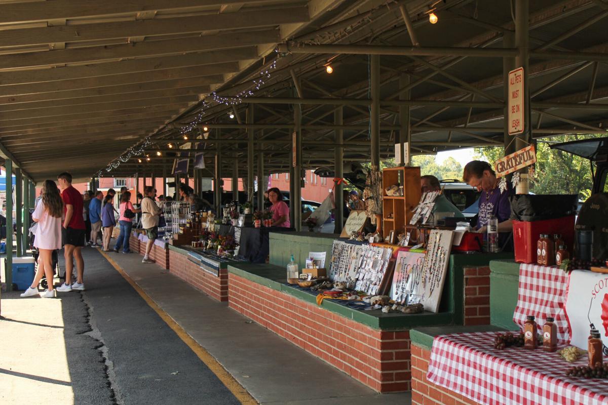 Vendors sell fresh produce at Nacogdoches Farmer's Market