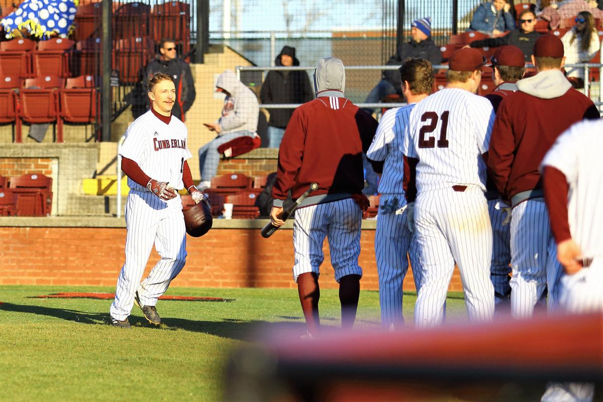 Kemper Dixon is greeted by his teammates following a home run.