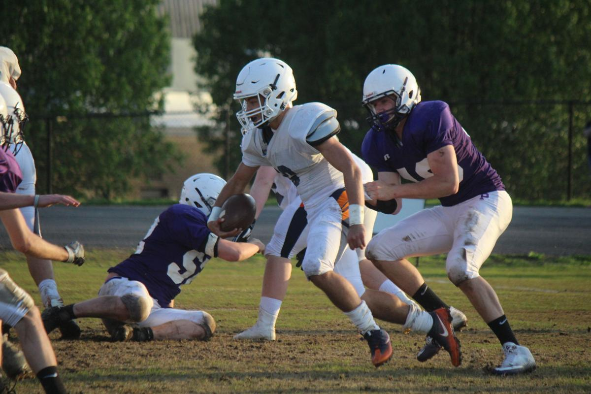 James Tice grabs and holds on to Beech running back Aaron Fox during the Panthers scrimmage. .JPG