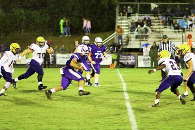 Panther Devyn Fuqua is swarmed by Yellow Jackets in the first quarter as he rushes up the middle.