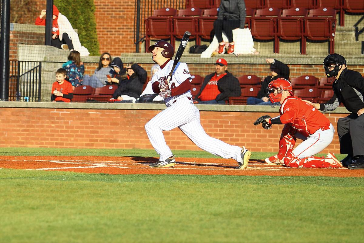 Kemper Dixon smokes a home run to left field in his second at-bat his senior year. .jpg