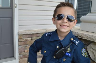 Kid cop is serving, protecting K-9 police
