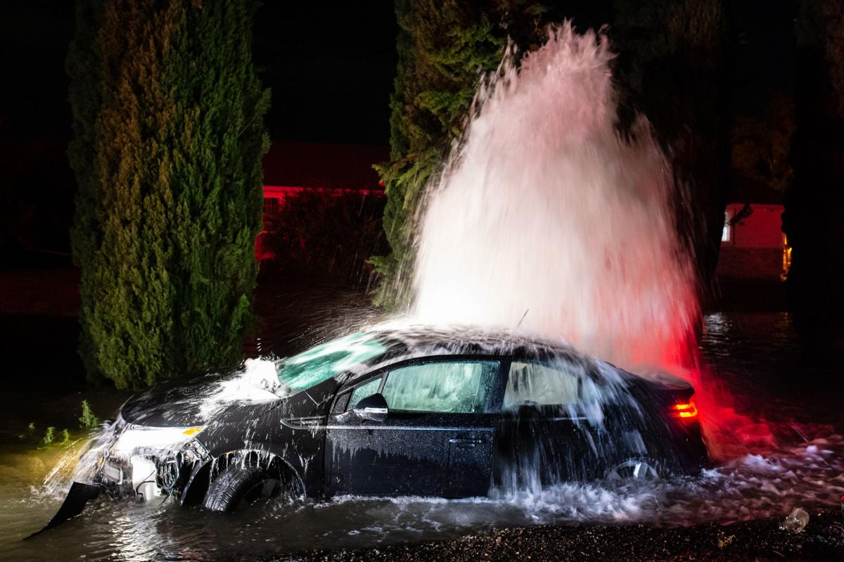 BN Car strikes hydrant-3499.jpg