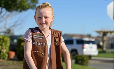 Oakley Girl Scout makes top sales, selling cookies from her front porch