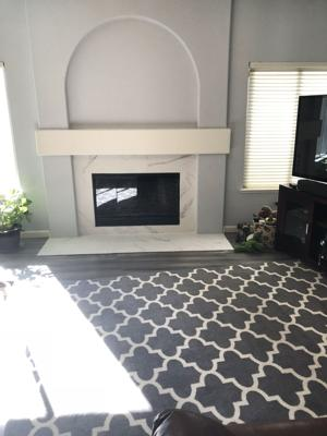 120518 after remodel Marble fireplace.jpg