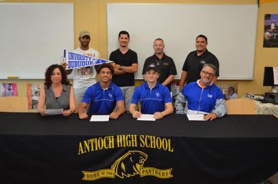 Antioch wrestlers sign to Dubuque