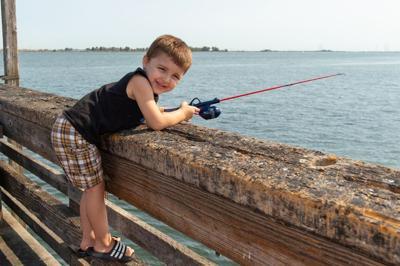 Logan Vane tries his luck during Oakley Kids Fishing Derby