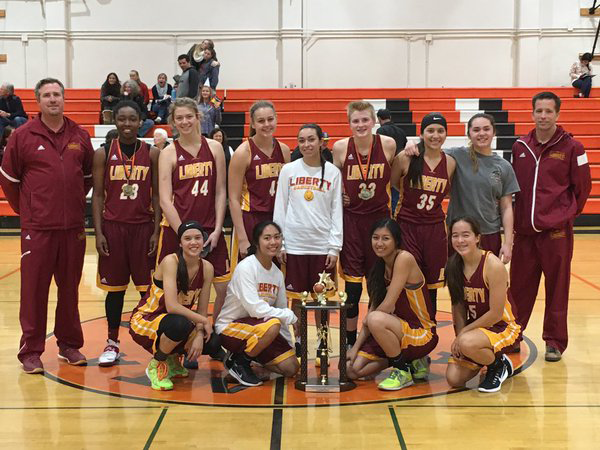 heritage  liberty basketball teams undefeated after tournament wins