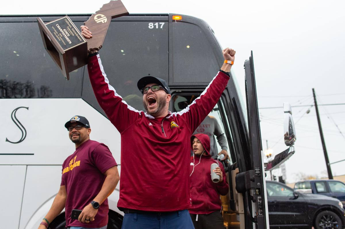 Liberty state champions arrive home