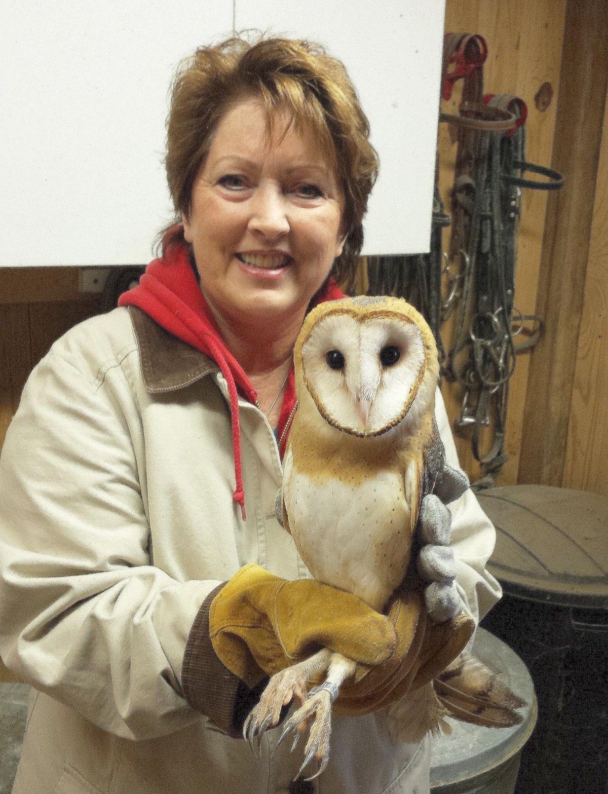 Paula Schenck holding a barn owl