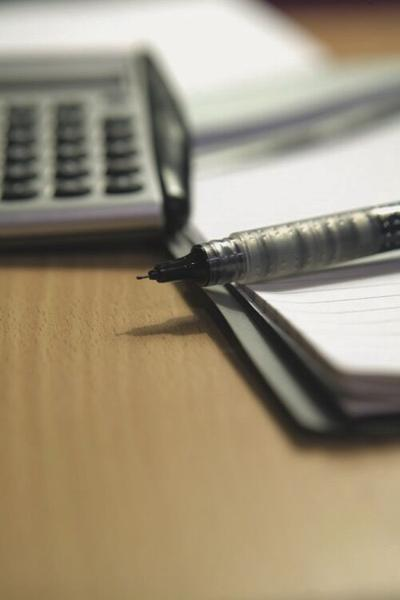 pen, pad and calculator