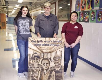 Tim Knight stands with art students Isabelle Knaack (left) and Amy Chen