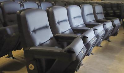 Theater seats, with rocking capabilities, were installed recently.