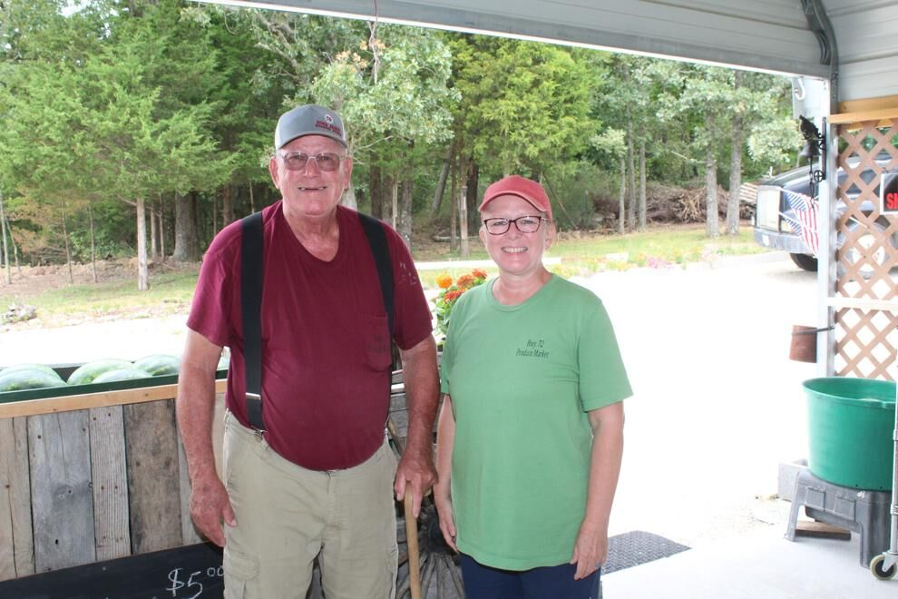 Norm Borgmeyer, with daughter Kim Nothaus, at the Highway 72 Produce Market.