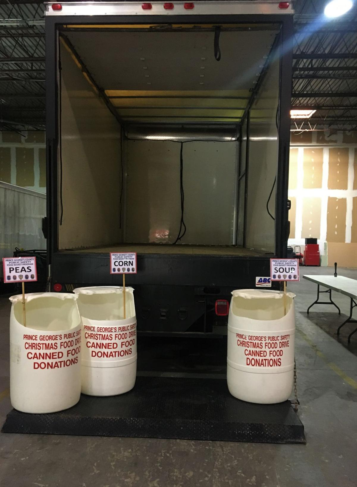 Proud to Give Back- Truck and Barrels