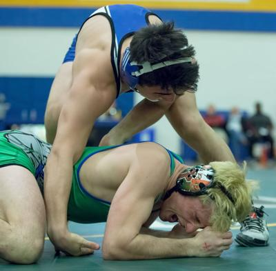 In a bit of controversy, Chris Sanchez of Sherwood slams Jack Connolly of Churchill to the mat just after the whistle. Sanchez held on for a 3-2 win in the 138lb weight class. PHOTO BY MIKE CLARK