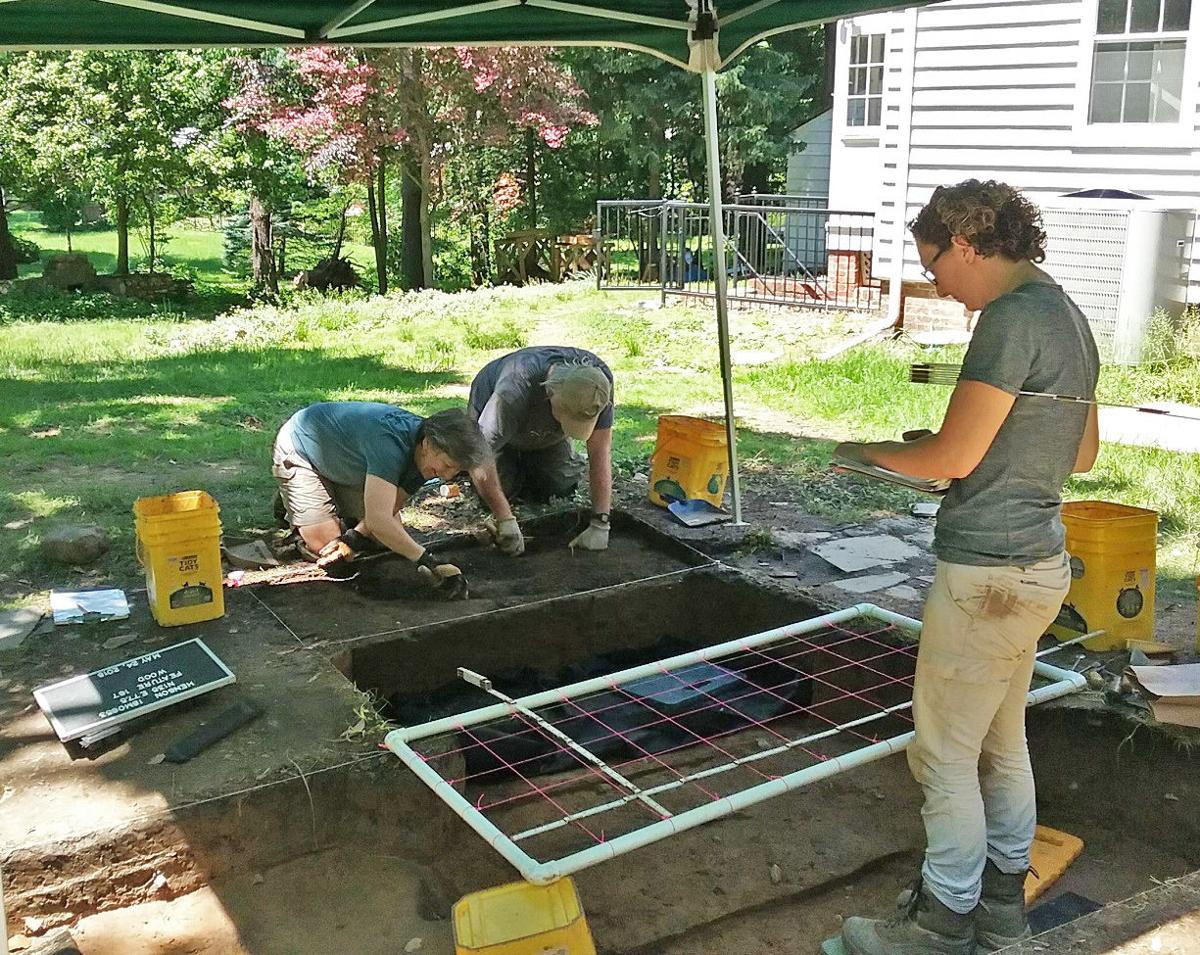 Kelly Horn, (right) County assistant archaeologist, and volunteers Fran Kline of Rockville and Tom McLaughlin of Silver Spring have uncovered many items dating back to the days of slavery. PHOTO BY SUZANNE POLLAK