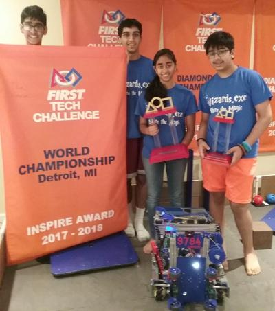 Wizards.exe team members Rohan Dewan, Ishaan Oberoi, Devasena Sitaram, and Arjun Oberoi show their winning robot and the trophies they earned in recent international competition. PHOTO BY SUZANNE POLLAK